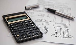 calculator next to financial documents