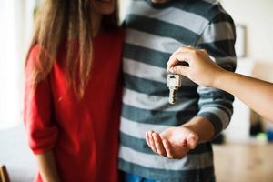 Couple receives keys to their new home
